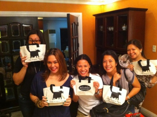 Holding their JAM's Angus Tapa packages with pride. =)